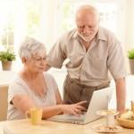 Elderly couple using computer